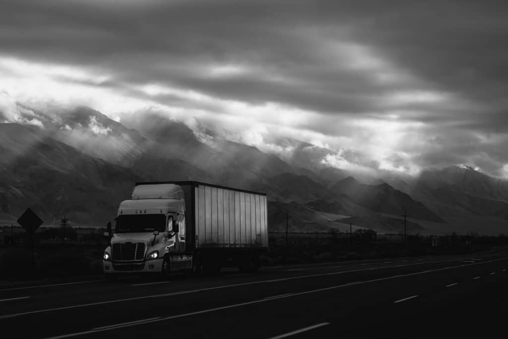 A dry van truck on an open highway.