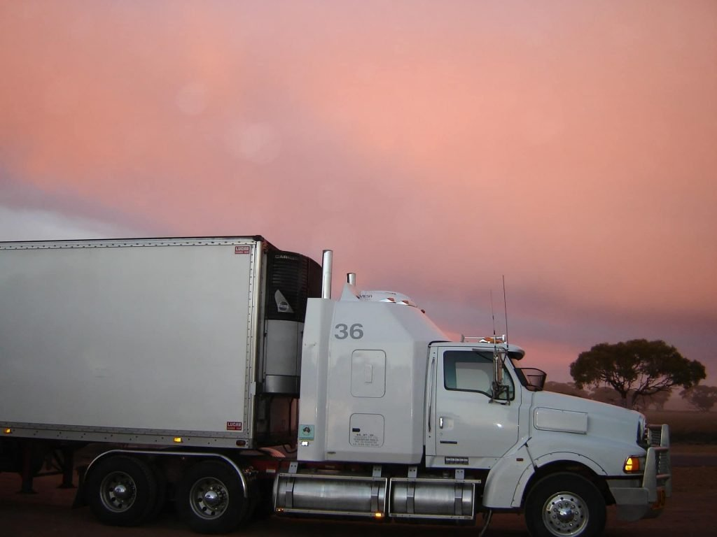 Refrigerated tractor-trailer on the road.