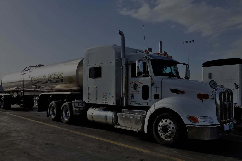 A tanker truck on the road.