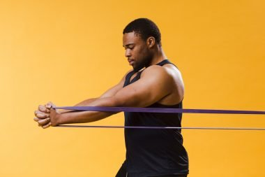 A person doing workout with a resistance band.