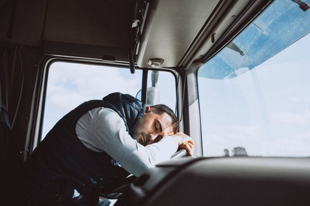 A truck driver fallen a sleep in front of the wheel