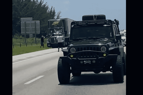 VIDEO: Florida Man Rides a Hood of a Truck for Nine Miles