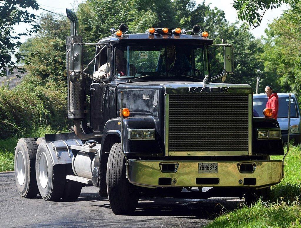 A black Mack Super-Liner tractor truck