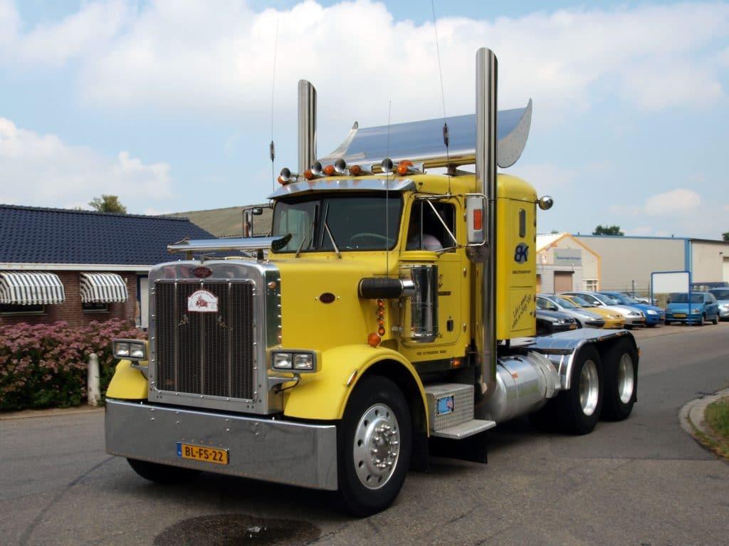 A yellow Peterbilt 359 tractor truck