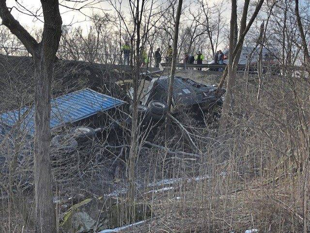 Trucker Trapped in Cab After Rolling Down an Embankment