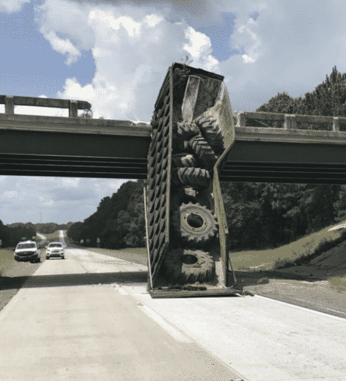 trucker who shifted bridge cited
